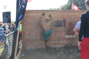 Climbing a wall to get to the starting line